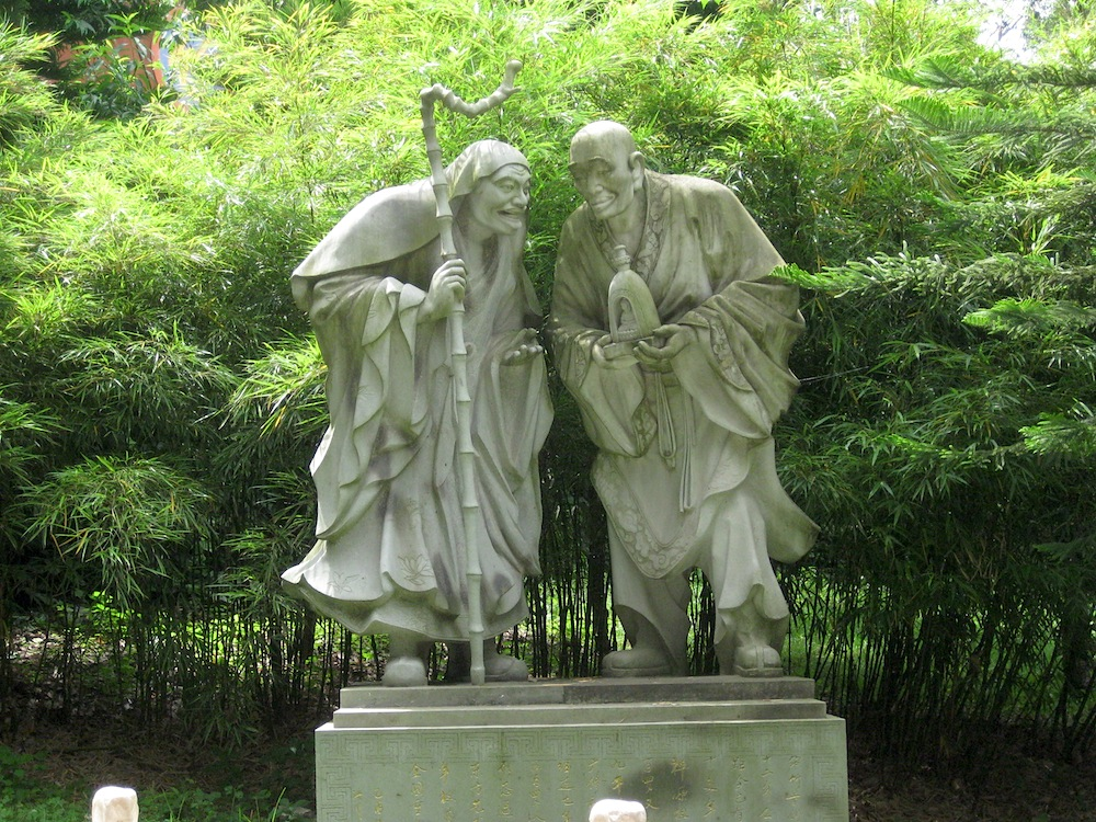 A stone statue of arhats on the temple grounds