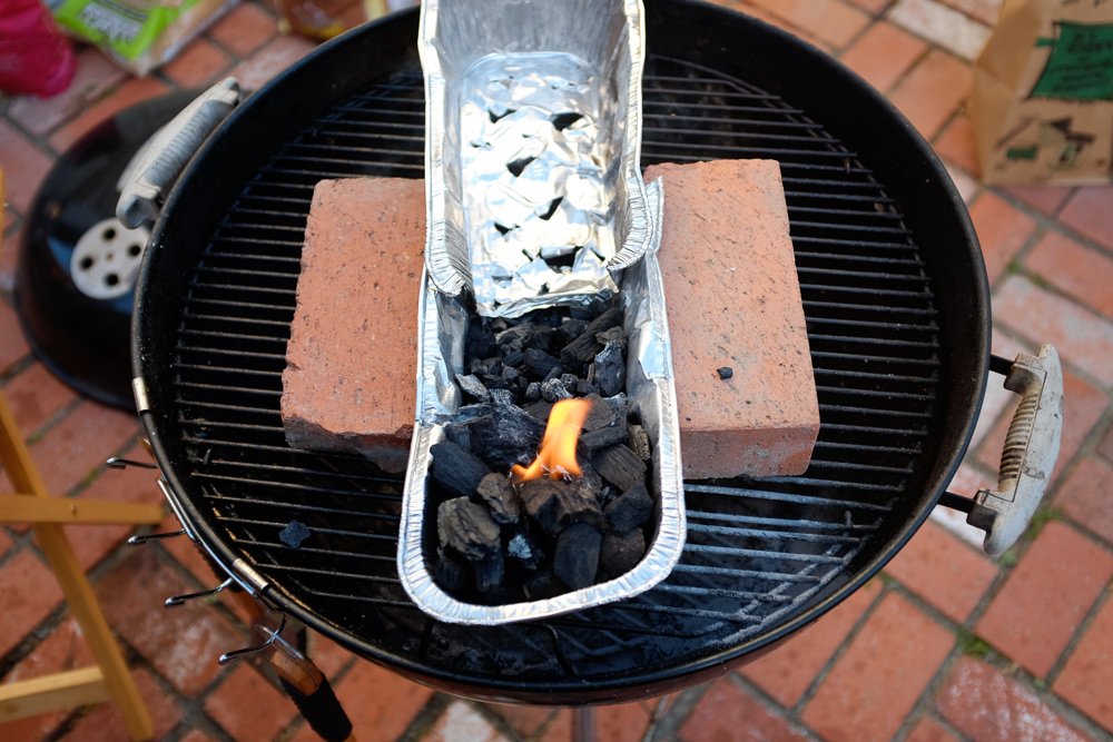 Preparing the coals in a makeshift shao kao grill