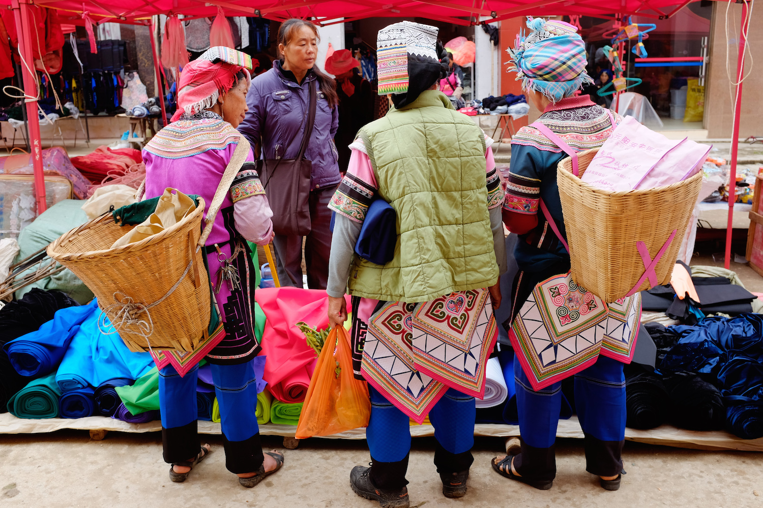 Yi  minority women shopping for cloth