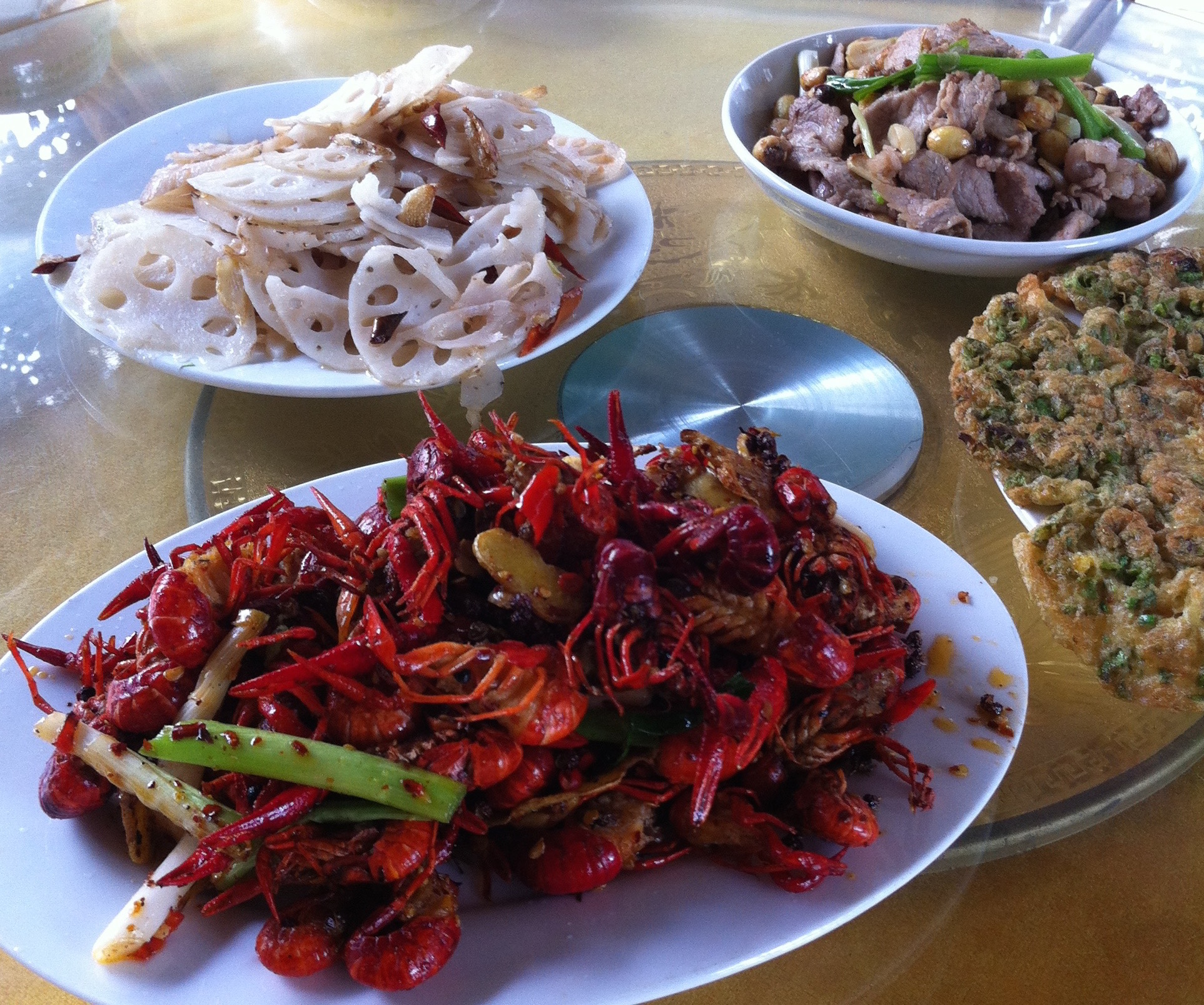 Lunch pulled from the lake: crawfish, lotus root, pork with lotus seeds, and eggs with lotus leaf.
